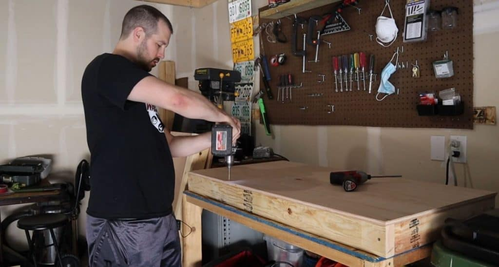 attaching top of cornhole board to frame